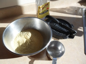 Assemble the ingredients: 2 cups masa harina, 1 1/2 - 2 cups hot water and 1/2 tsp. salt