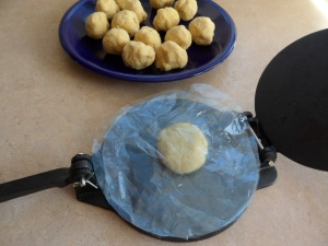 Set the dough ball between 2 sheets of plastic.