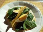 Spinach with hard-boiled egg salad in corn tortilla